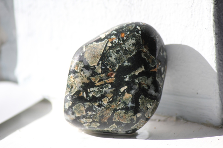 A beach-tumbled piece of dallasite jasper from Vancouver Island.