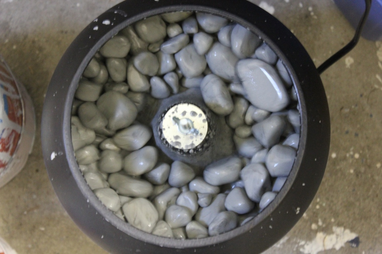 A top-down shot of my Thumler UV10 Industrial vibratory rock tumbler. The rocks vibrate and move their way up the walls, then tumble into the middle and slowly go round and round the bowl.