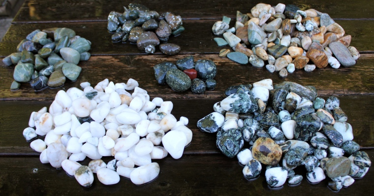 Clockwise from top left: greenstone (some jasper, believe some serpentine and other), speckled common opal in basalt, gneiss/quartz/river rock/petrified wood, Dallasite, quartz. Middle: Flowerstone, other porphyries and single piece of red jasper.